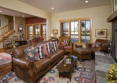I like the mix of floral and gingham pillows which make the leather couch more 'country.'