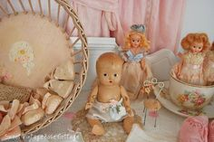 Vintage Dolls and Wicker Bed