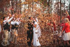 Fun Bridal Party Photo - Bride & Groom playing in the leaves
