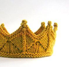 Oooo I love this! For purchase - Antique Gold Lace Knit Crown - from laceandcableon Etsy.
