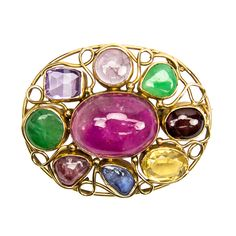 Retro Multi-Stone Oval Brooch Pin | From a unique collection of vintage brooches at http://www.1stdibs.com/jewelry/brooches/brooches/