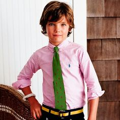 Pink Polo shirt and green tie