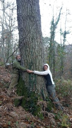 I and Francesco we are not big enough to completely hug the big oak. We love trees!