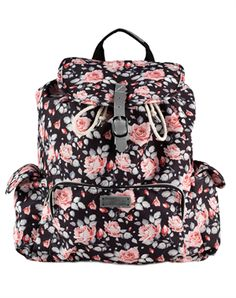 This fashionable backpack measures approximately 17 tall by 11.5 long by 5 wide and features:  Cross Studs on front exterior Drawstring and Strap and Buckle closure. Metal eyelets Metallic finish on strap closure, handle, and placket Large main interior pocket 1 exterior zipped pocket on front 2 open side pockets Adjustable back straps Material: Canvas Printed in:  USA Produced in: China - Fair Labor Policy