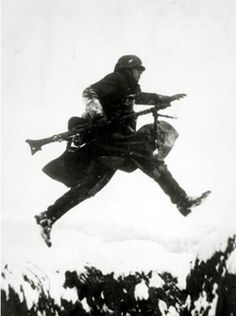 """kruegerwaffen: """" March 1940, A German soldier leaping a snow covered ditch on the western front, Germany's victory in France in 1940 followed the 'Phoney War, (September 1939-April 1940) and the German breakthrough accomplished at great speed meant... pin by Paolo Marzioli"""