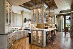 Fabulous Curio Cabinets Design In Rustic Kitchen With White Colored Wooden Material Which Has Black Colored Handle #modern design,  #antique commodities -  furniture