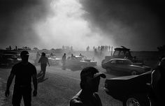 Photo by Trent Parke. This image has mood and I like the dust and hats. What a great scene from a drag race, contrast, silhouetted men and cars. Black and white gives it depth and drama...