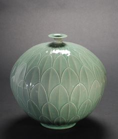 "Water Jar, Korean ""Celadon"" vase with lotus leaves. Celadon is a term for pottery denoting both wares glazed in the jade green celadon color, also known as greenware (the term specialists now tend to. Glass Ceramic, Ceramic Clay, Ceramic Plates, Ceramic Pottery, Pottery Art, Kintsugi, Korean Art, Asian Art, Korean Pottery"