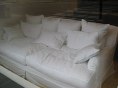 I'm so in love! This looks like the best hardcore cuddle couch! Well, except for the fact that it's white ~ Probably not the best color for me, considering I'm a little clumsy sometimes. Daydreaming of having a couch like this! Being wrapped up in the warmth of a mans arms ~ feeling safe and secure! Attempting to watch a movie... Cuddling, snuggling, wrestling, giggling, talking, kissing... And maybe then some! Lol Sounds like some perfect nights in <3 Or... Maybe just read a book :)