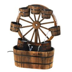 This impressive all wood water fountain stands 33 inches high. The rustic wagon wheel holds 7 water buckets for lots of lovely falling water sounds.