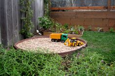 This is a great way to include an area for diggers, which are an essential element of children's gardens.