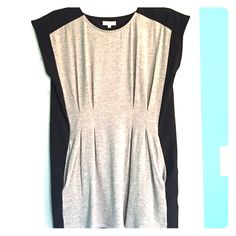 Anthro Weston top Grey jersey front with elegant darting and hour-glass shape, back and sides are elegant black. Flattering and a generous XS. Like new, no signs of wear. Anthropologie Tops Blouses