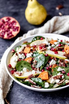 Roasted Sweet Potato, Pear & Pomegranate Spinach Salad Beautiful and festive roasted sweet potato, pear and pomegranate spinach salad with creamy goat cheese, toasted pecans and a tangy balsamic dressing // Ambitious Kitchen Easy Spinach Recipes, Vegetarian Recipes, Healthy Recipes, Clean Eating Snacks, Healthy Eating, Healthy Food, Pomegranate Salad, Fruit Salad, Pomegranate Recipes