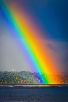 Rainbow ending in Tramp Harbor in the Puget Sound near West Seattle, WA, USA
