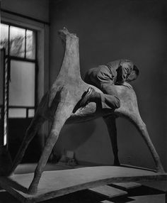 Herbert LIST :: Marino Marini (sculptor) in his studio on one of his horses / Milan, Italy, 1952