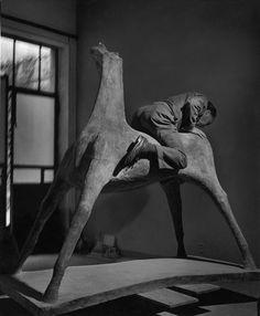 Herbert LIST :: Marino Marini (sculptor) in his studio on one of his horses / Milan, Italy, 1952