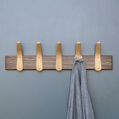 We design and make everything by hand from our Suffolk workshop. The coat hooks are very strong and ideal for fixing to walls, doors and furniture woodwork. We steam bend the hooks into shape from a single piece of wood and finish every hook by hand to create these coat racks. -Hook size: L15cm x