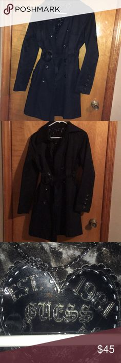Guess trench coat Black tench coat from guess size medium  Like new no damage worn twice to formal events.  The leopard print that's photographed is super soft and fuzzy.  Armpit to armpit - 14, Sleeve armpit to bottom of sleeve -18 inches Top of collar to bottom 35 Under waist belt to bottom 18 Guess Jackets & Coats Trench Coats