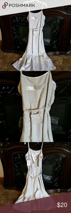 Linen wrap dress Tan linen wrap dress with satiny accents. Has a cute pocket on the front and also has a belt with attached pocket that is good for traveling. I had bought this dress for traveling but ended up not liking how it fit. The dress wraps in the back and is held in place by buttons. Newport News, size 14, NWT. Newport News Dresses Maxi