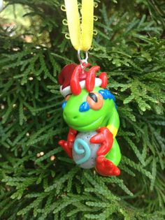 World of Warcraft Inspired: Festive Murloc Holiday by TheTallGrass What could be more festive for that Warcraft player than a beloved Murloc in a Santa Hat! And did we mention the Hearthstone he holds in his cold, slimy hands glows in the dark?  This cute little Murloc is the perfect ornament for the Christmas season! And we promise he won't eat your other ornaments! ... at least we think... he is a Murloc after all!  He is fashioned on a colored ribbon to hang from any branch on your tree