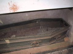 An open coffin in an abandoned graveyard amongst the ruins of the Jesuit mission of Santa Ana in Argentina.