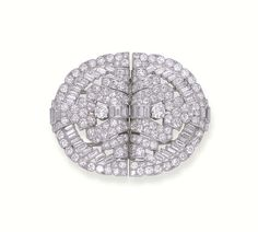 AN ART DECO DIAMOND DOUBLE-CLIP BROOCH, BY CARTIER -  Each openwork clip designed with a pavé-set diamond and diamond collet geometric centre to the baguette and brilliant-cut diamond borders, mounted in platinum, circa 1935