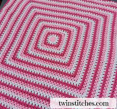 "The Wobbly Squares Blanket is a square v-stitch blanket made with double crochet together stitches instead of traditional plain double crochet pattern. The dc2tog (double crochet together) pattern is addicting and soothing to use and creates a lovely ""wobbly"" square pattern."
