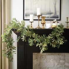 Enjoy classic Mediterranean style for the holidays and all year round with our 6' Olive Leaf Garland. Meticulously hand crafted to look just like the real thing, this lush faux garland is handmade with soft fabric green leaves you can fluff for a natural look. This fake greenery olive branch looks good as mantle decor or banister greenery. #MantleDecor #BanisterDecor