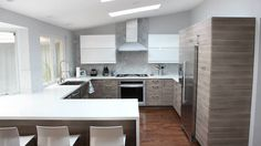 IKEA's Sektion cabinets in Brokhult Walnut Gray with white counters