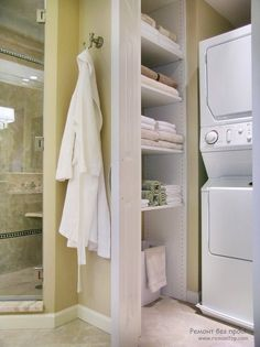Small Bathroom Designs With Washer And Dryer stacking washer and dryer are concealed behind frosted glass doors