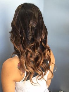 Gorgeous balayage on a dark espresso brunette base with bright, sunkissed ends by Gila Rut Aveda stylist Christine at Gila Rut Torrey Hills.