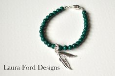 A Cup of Teal Feather Bracelet by LauraFordDesigns on Etsy, $25.00