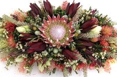 Awesome display of S. African and Australian Natives. Casket Flowers, Funeral Flowers, Wedding Flowers, Wedding Bouquets, Funeral Arrangements, Christmas Arrangements, Flower Arrangements, Table Arrangements, South African Flowers