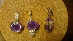 Wire Wrapped Amethyst point necklaces.