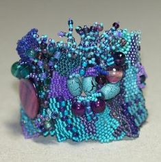 Mountain Sky... Freeform peyote bracelet in shades of teal, turquoise, and violet. One of a kind and stunning! $ 119, from time2cre8 :-) by cristina.jelescu.5