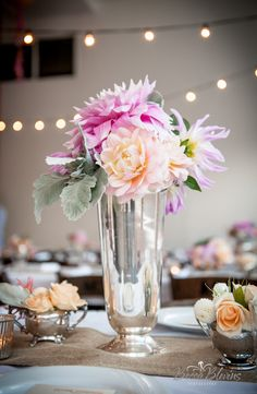 Silver vessels and small floral arrangements that could easily be DIY.