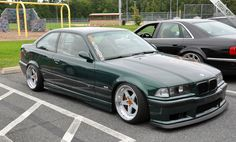 Dark green BMW e36 coupe on cult classis Cromodora Bully wheels