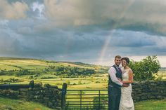Bride & Groom under a rainbow, Danby Castle, Whitby North Yorkshire. www.njphotographic.co.uk