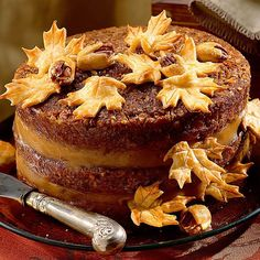 Bring the best of pecan pie to a Thanksgiving-worthy pecan pie layer cake. This way, you'll never have to choose between a slice of cake and a piece of pie again.