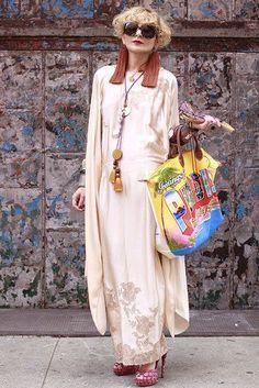 Catherine Baba in cream silk and tassel earrings.