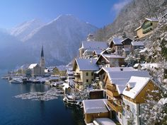Hallstatt, Austria- take a ferry across the lake to get to the village. Take the tram up the mountain and tour the old salt mine. Great Christmas trip!