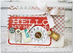 "Everyday Eclectic 6x6 Paper Pad by Echo Park  The Sweetest Thing 6x6 Lavender Paper Pad by My Mind's Eye  The Sweetest Thing Hello Die-Cut Label by My Mind's Eye  The Sweetest Thing Perfect Tiny Word Stickers by My Mind's Eye  The Sweetest Thing Cutie Pie Buttons by My Mind's Eye  Natural 1/2"" Crocheted Ribbon by May Arts  Clock Faces Junkyard Findings by Prima  The Sweet Life Cutouts Die-Cut Sheet by Elle's Studio"