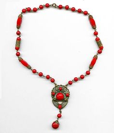 Early 20th C Bohemian brass filigree and red glass necklace. (nlbg1025) by EarthlyAdornments2 on Etsy https://www.etsy.com/listing/238366382/early-20th-c-bohemian-brass-filigree-and