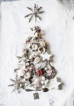 frosted decor: simply find old ornaments and festive tchotchkes around your house, arrange & spray them with white & silver