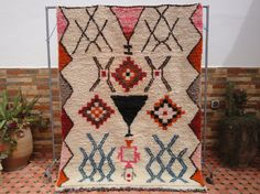 beni ouiran carpet hand-woven with pure sheeps wool that is natural white with…