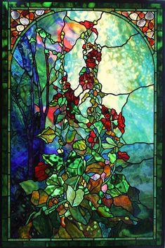 Inspired by the elaborate pictorial windows of Tiffany Studios, Century Studios windows often include plated layers of glass which create colors and textures that do not exist in a single sheet of glass. Facial features in figural work are hand painted with powdered minerals and kiln-fired to become part of the surface of the glass. Hollyhocks - Created in 2013