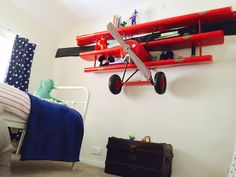 Amazing book Shelves Plane wall shelving Replica airplane Red baron model shop, cool aircraft store for A big red baron replica kits the fokker Wall Shelving Units, Wall Bookshelves, Wall Shelves, Book Shelves, Airplane Bedroom, Airplane Decor, Airplane Lights, Retro Furniture, Kids Furniture