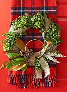A plaid scarf sounds a bright note behind this wreath. More holiday wreaths: http://www.midwestliving.com/homes/seasonal-decorating/beautiful-holiday-wreaths/?page=10,0