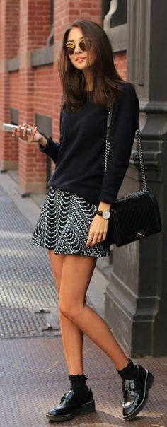 Street style | Black sweater, patterned mini skirt, flats, purse