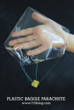 Plastic Bag Parachute - learn how to make a parachute.  So much fun for kids!
